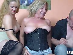 First threesome for a mature blonde in a black corset