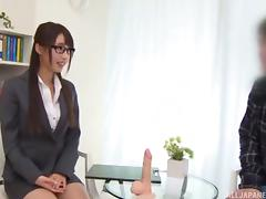 During a job interview a cute Japanese girl jerks a guy off