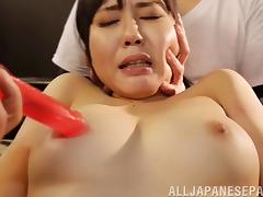 Intense bondage where a Japanese girl is pounded by a fuck machine