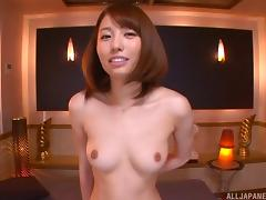 Very attractive and slim Japanese girl giving a handjob and footjob
