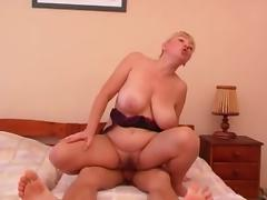 Russian blonde MILF with enormous natural tits fucking passionately