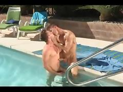 Two gay hunks muscle men fuck by the pool