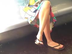 Candid crossed legs and flip flops