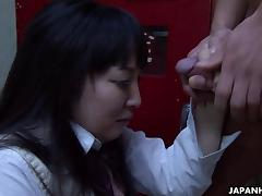 Asian school girl sucking hard on the fat don