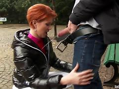 Hot redhead sucks cock in public and gets pissed on