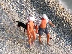 Nudist couple living the thug life. just fucking at the beach in public !!!