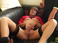 Mature slut shows off her natural tits and pierced shaved pussy