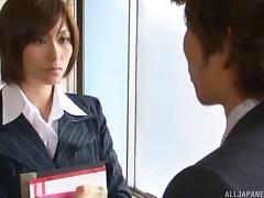 Beautiful and clothed Japanese MILF receives a deep mouth fucking