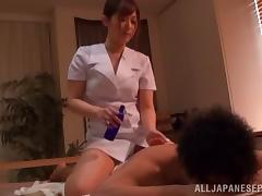 Japanese MILF masseuse oils up a man's body and rides him passionately