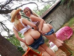Giggly cowgirls showing off their nice asses outdoors