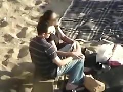 Voyeur tapes a couple having sex in the dunes during daytime