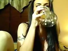 Spicy hot webcam model with big boobs definitely loves her glass dildo