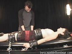 fully clothed man performing hardcore fetish action with an attractive lady