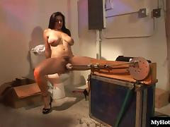 Busty Latina Raylene uses a fucking machine in her pussy and ass