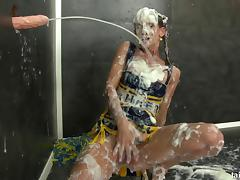 Cheerleader covered in huge fake cumshots at a gloryhole
