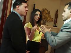The boss's wife fucks the new guy at office while her husband is in a meeting