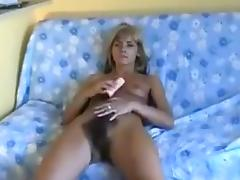 Amateur blonde called Monika toys her super hairy coochie