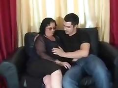 Chubby brunette cougar submits to my young friend on the sofa