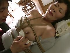 Asian rope bondage where she gets tied up and fucked