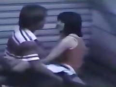 Voyeur tapes an asian girl couple fucking on the pavement in public