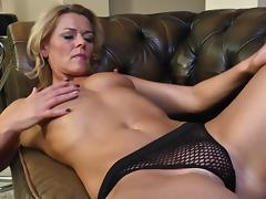 Blonde goddess gets on the couch to engage in the solo adventure