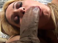 Hot fishnet-clad tranny with long blonde hair and a big cock enjoying hardcore interracial sex