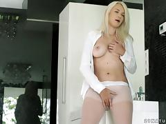 She drills her glass toy into her pussy in a close up video