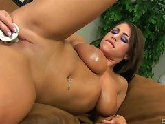 Big breasted beauty fucks her hot pussy with dildos