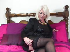 Hot mature blonde with sexy curves rubs her wet pussy