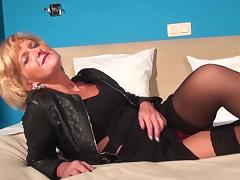 Mature blonde breaks out her vibrator and fucks herself with it