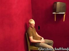 Horny blonde gay guy sucks the dick through a gloryhole