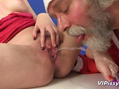 Santa pisses on a pretty girl and fucks her hardcore