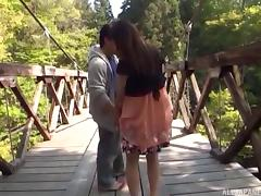 Cute Japanese girl on the bridge flashing and getting licked