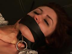 Redheaded slave in a collar throat and ass fucked