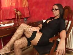 Vixenish brunette milf in glasses strokes her pussy gently with a toy