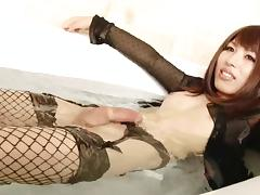 Japanese tgirl in sexy black fishnets strokes her sexy dick