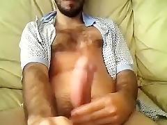 Nice-looking boy is jerking in the bedroom and filming himself on webcam