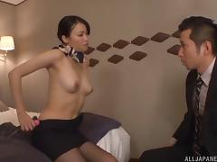 Stewardess in a skirt and pantyhose fucks in a hotel room
