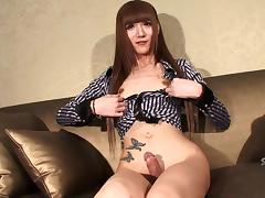 Tall trans chick drops her shorts and plays with her dick