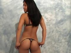 Asian maid with the tanned skin shows off her succulent body