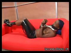 Ebony-skinned sex slave with big tits tied-up on her sofa