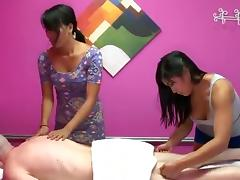 Horny Asian babes turn a massage session into a thrilling ffm fucking