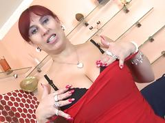 Mature redhead senorita has a black toy and intends to use it