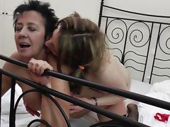 Naughty granny loves licking a hot brunette's tight twat