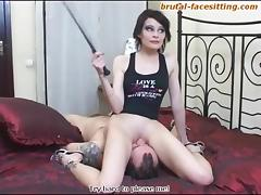 Short-haired mistress with a femdom fetish doing some facesitting
