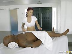 Gorgeous redhead with tattoos getting treated by the horny black men