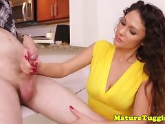Glam milf beauty giving silent handjob