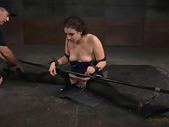Seductive minx enjoys being restrained and sucking on cocks