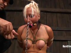 Blonde babe in bondage yelling when tortured in BDSM closeup