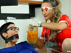 Latex nurse pours thick yellow goo on a babe in a blouse